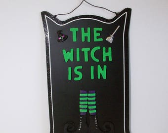 The Witch is in metal sign with polymer clay letters and witch shoes