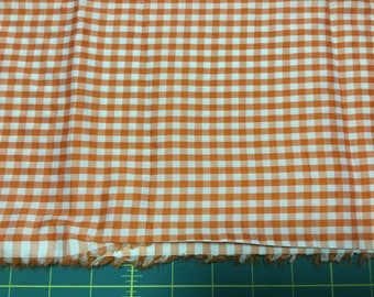 "Orange Gingham fabric. Windbreaker-type  1/4"".    1-1/2 yards"