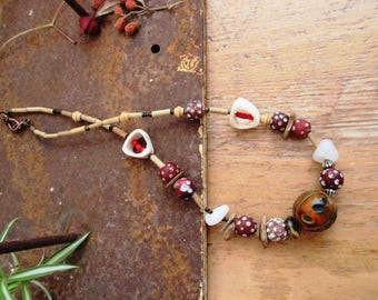 "A necklace of legends with African beads of collections: ""The Past Of The World"" ...."