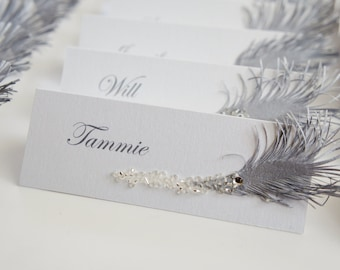 Winter wedding place cards with silver feather & rhinestones
