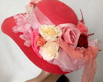 A Pink Sherbet Wide Brim Weave Church Hat Decorated With Organza and Flowers