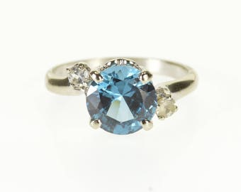 10k London Blue Topaz Cubic Zirconia Accent Bypass Ring Gold