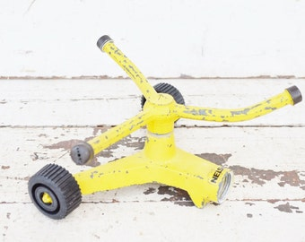 Vintage Nelson Spinning Sprinkler Rotating Yellow Chippy Paint Metal Rolling Wheels Lawn Garden Summer Fun 1970's
