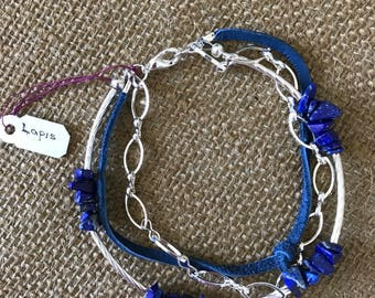 Blue Lapis, Suede an silver multi strand.  Very light in weight .  8""