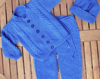 Baby infant boy toddler hand knitted blue traditional matinee outfit of jacket / cardigan trousers / leggings / pants pom pom hat pram set.