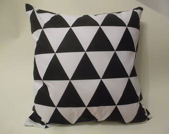 Square cushion with black and white geometric pattern