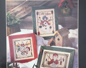 Snow Folks counted cross stitch pattern