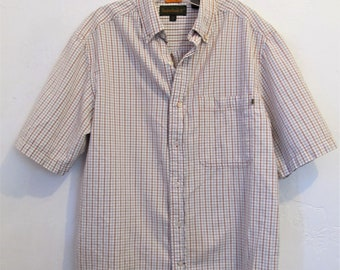 A Men's Vintage 90's,White Short Sleeve Checkered URBAN era Shirt By TIMBERLAND.M