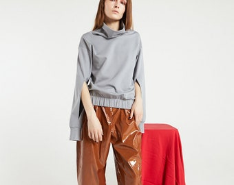 Sweatshirt with cut-out sleeves
