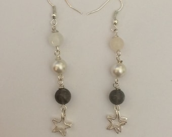 Pendant earrings with moonstone and stars.