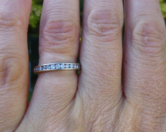 Channel set 25 point..White gold....wedding band.....engagment ring...stacker band