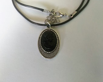Handmade silver colored necklace with cameo made out of coal