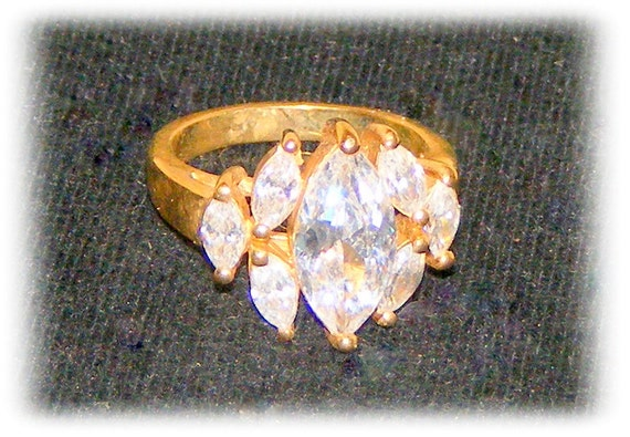 GOLD TONE RING with marquis shaped faux diamonds (sz 7)   (Ladies Ring)