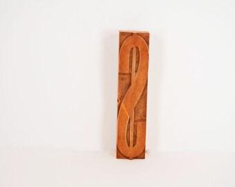 Large vintage Dollar sign - type set made of wood