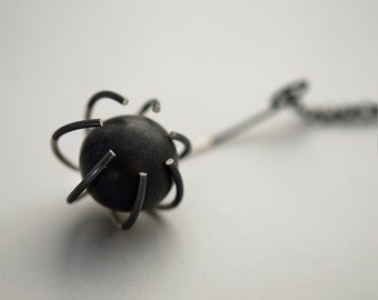 """Contemporary necklace. """"Trapped"""" series. Black polymer clay stone in silver """"cage"""". Short chain. Matt finish. Handmade. Ready to ship."""