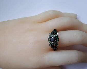Green jewel gun metal black band ring