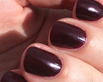 Scum and Villainy Nail Polish - burgundy jelly with subtle purple and pink shimmer