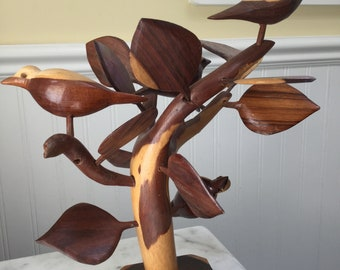 Unique Carved Birds on a Branch