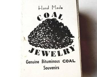 Pair of Souvenir Black Coal clip on Earrings in Original Box