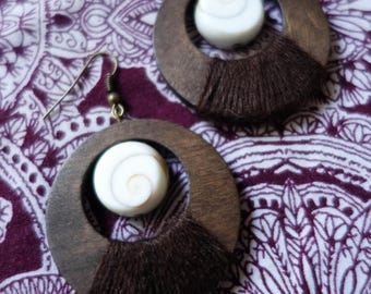 Brown hoop earrings and shiva eye shell, wood