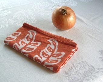 batik tea towel. earth orange seedlings