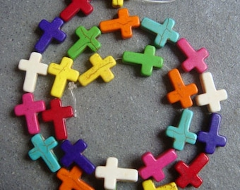 5 MIXED 16 X 12 MM TURQUOISE CROSS BEADS.