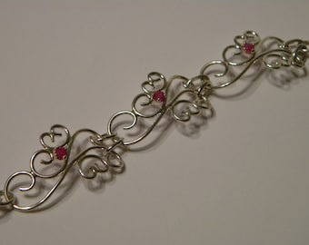 Silver scroll bracelet with Rubys