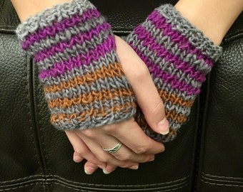 Hand knit hand warmers are knit in a cozy wool