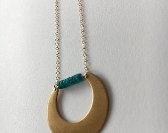 brass horseshoe with turquoise bar on gold chain