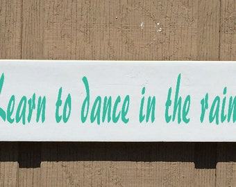 Learn to dance in the rain sign