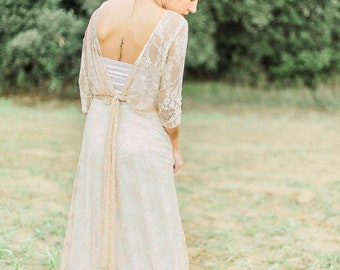 Backless bridal gown with sleeves, Long sleeve bridal gown backless, Backless lace bridal gown, Lace bridal gown low cut back