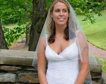 Wedding veil -  cascading cut fingertip length bridal veil wit a cut edge