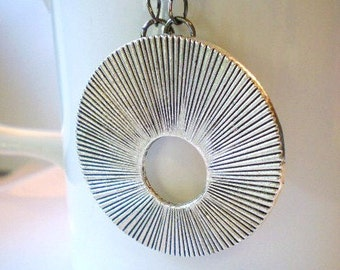 Sunburst Eye Glasses Holder, Silver Tone Textured Disc, Onyx and Gunmetal Necklace Chain