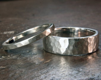 Recycled sterling silver 6mm and 2mm wide wedding ring set. Heavy planished finish. Hand made in the UK.