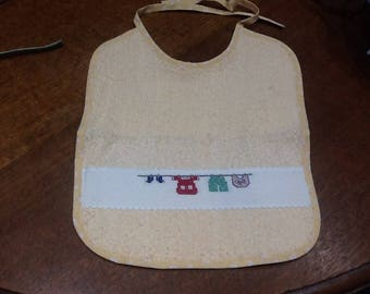 Small salmon embroidered Terry bib detergent