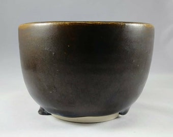 Brown ceramic cup