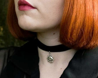 Black velvet choker with sun charm
