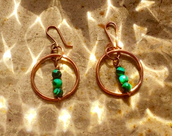 Copper earrings with small balls of malachite