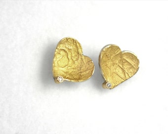 A gold heart! Gold and silver stud earrings with a small diamond and textured surface, Handcrafted earrings, Heart earrings, Gift for her.