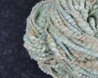 Handspun Yarn Bulky Coil Spun Sparkling Art Yarn 50 yards greenish blue tan