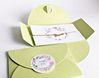 1x Love put on bracelets gold + green Packaging