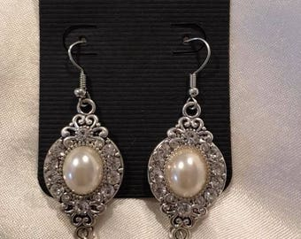 Broach style earrings with faux pearl center and three pearl drop