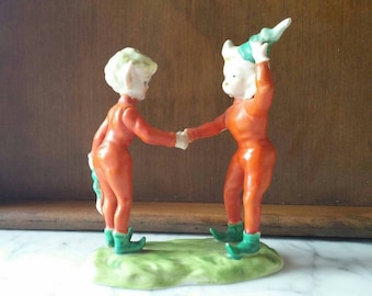 Vintage Ardalt Pixie, Elf figurine Orange Outfits with Green Hats standing on grass. Occupied Japan