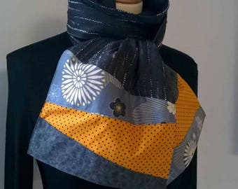 Scarf in Heather gray and end yellow-orange and grey fabric.