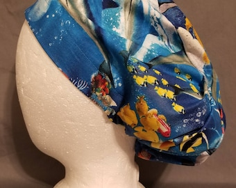 Euro style surgery scrub cap with marine mammals and reef fish