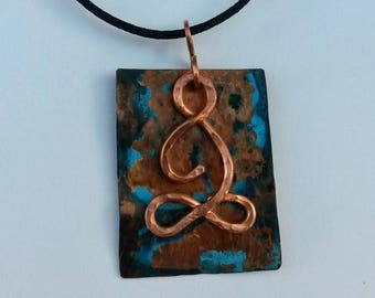 Rustic copper yoga pendant with blue patina lotus position
