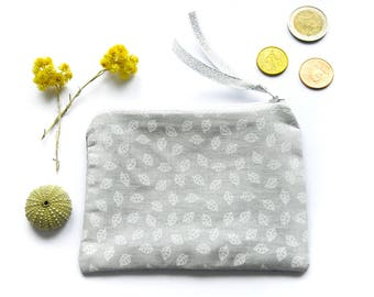 Fabric wallet white leaves on gray background, grey back