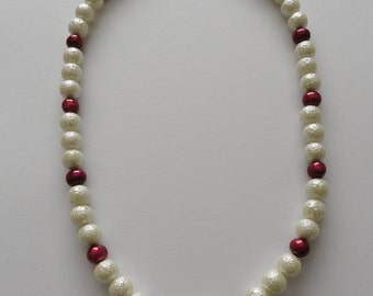 Cranberry fresh water pearl and ivory-coloured glass necklace