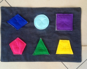 rug educational game in jeans and felt shapes and colors