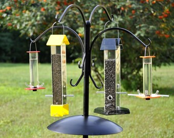 Four Feeder Package: A complete set designed to attract the widest variety of seed eating and nectar drinking birds to your yard!